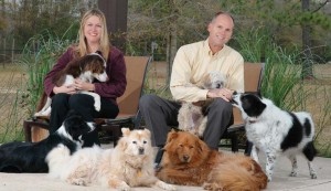 Mark and Jodi Busch with six of their rescues. Photos by John Stricklin. Click image to see full spread